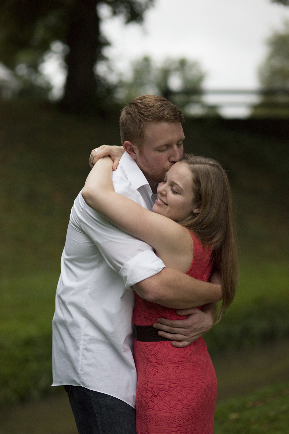 A sweet embrace during a beautiful engagement pictures in Downtown Staunton, Virginia
