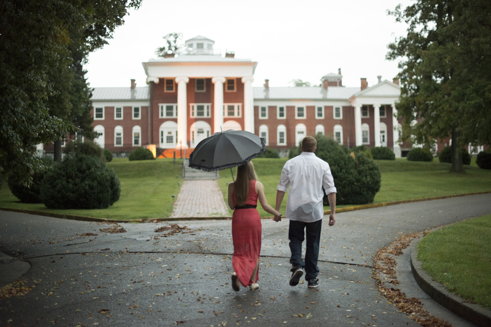 Walking hand in hand during a beautiful engagement pictures in Downtown Staunton, Virginia