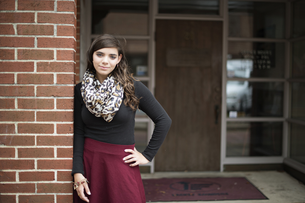 Downtown senior portraits | cranberry red skirt and leapord print scarf | Hampton, Virginia