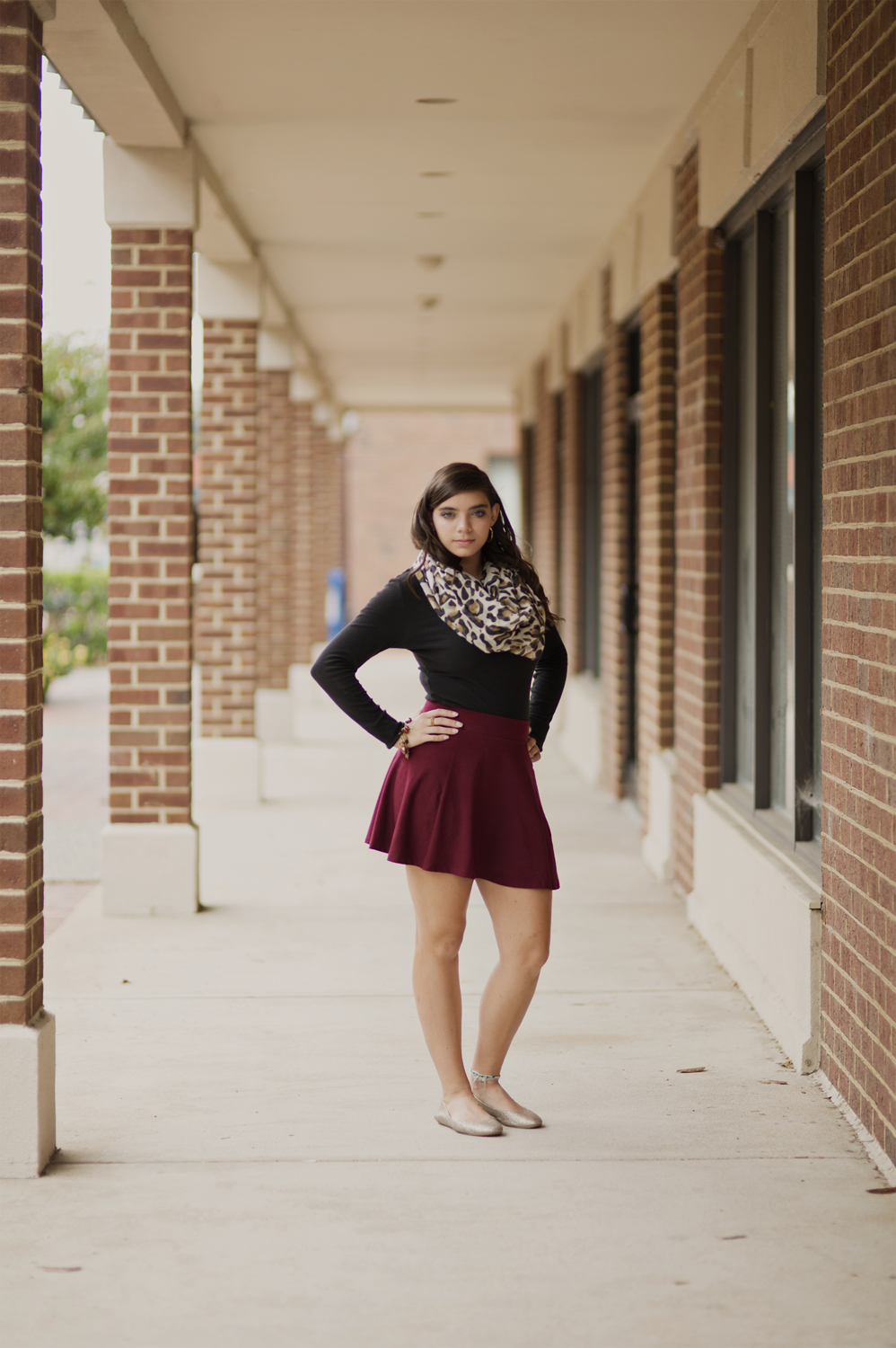 Downtown urban senior portraits | cranberry red skirt and leapord print scarf | Hampton, Virginia
