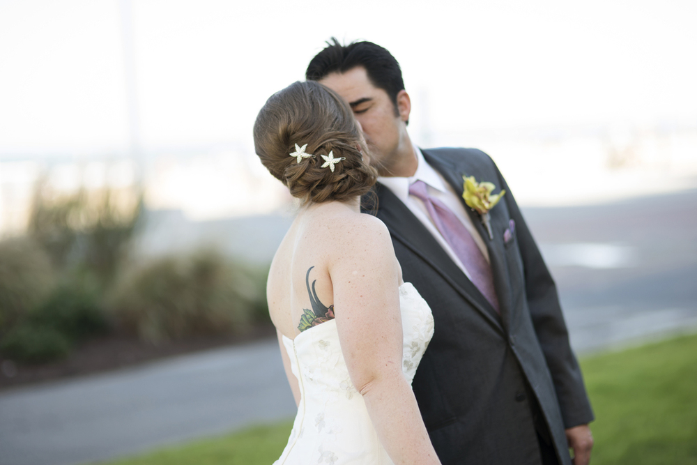 Bride and groom kiss during first look | Fall hotel wedding in Virginia Beach