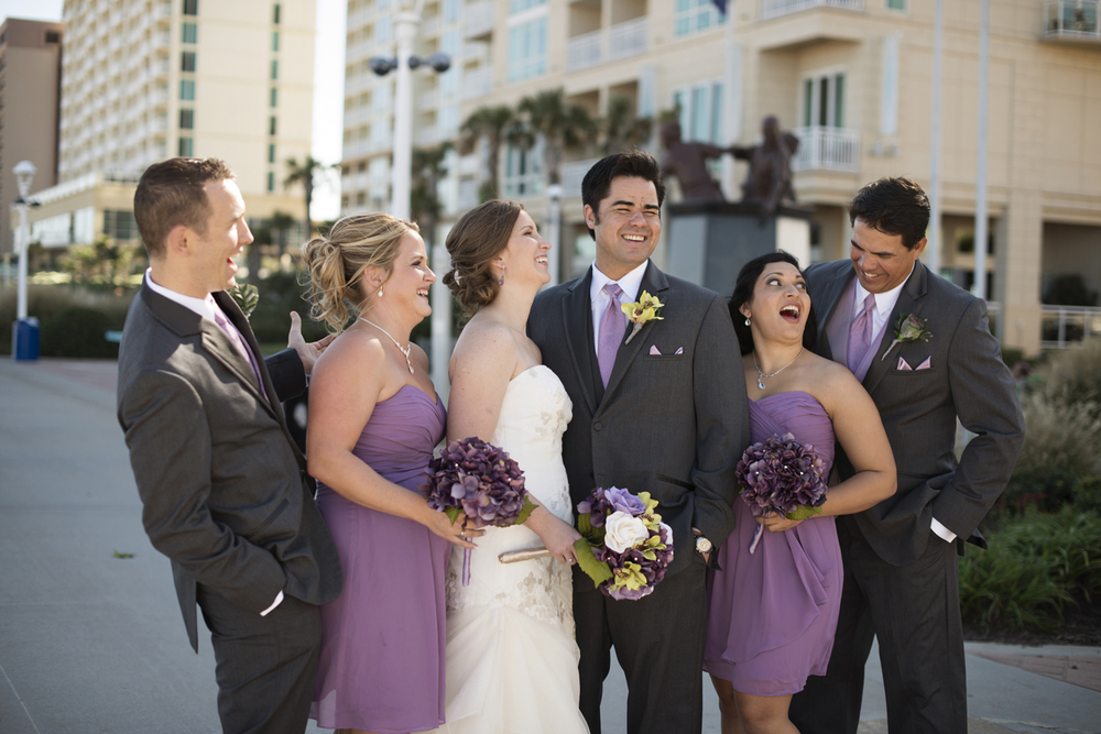 Fun wedding party pictures with purple and white dresses | Fall hotel wedding in Virginia Beach