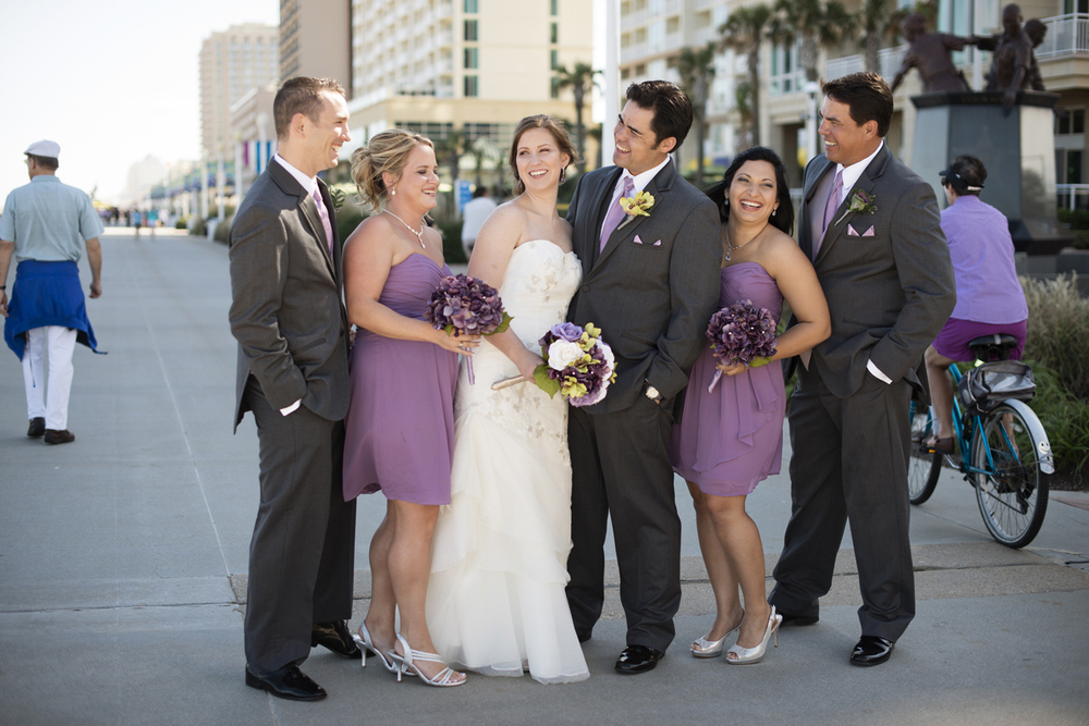 Fun wedding party pictures on boardwalk | Fall hotel wedding in Virginia Beach