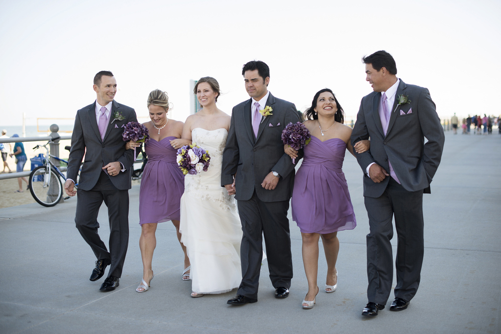 Bridal party walking on boardwalk | Fall hotel wedding in Virginia Beach