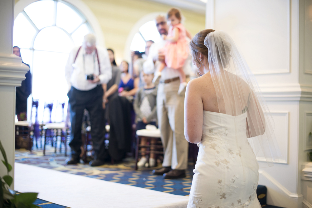 Bride walking down the aisle | Fall hotel wedding in Virginia Beach