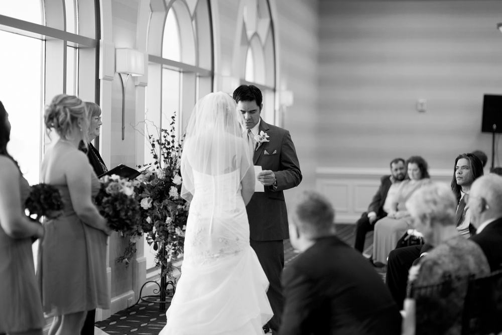 Groom reciting vows at his ceremony | Fall hotel wedding in Virginia Beach
