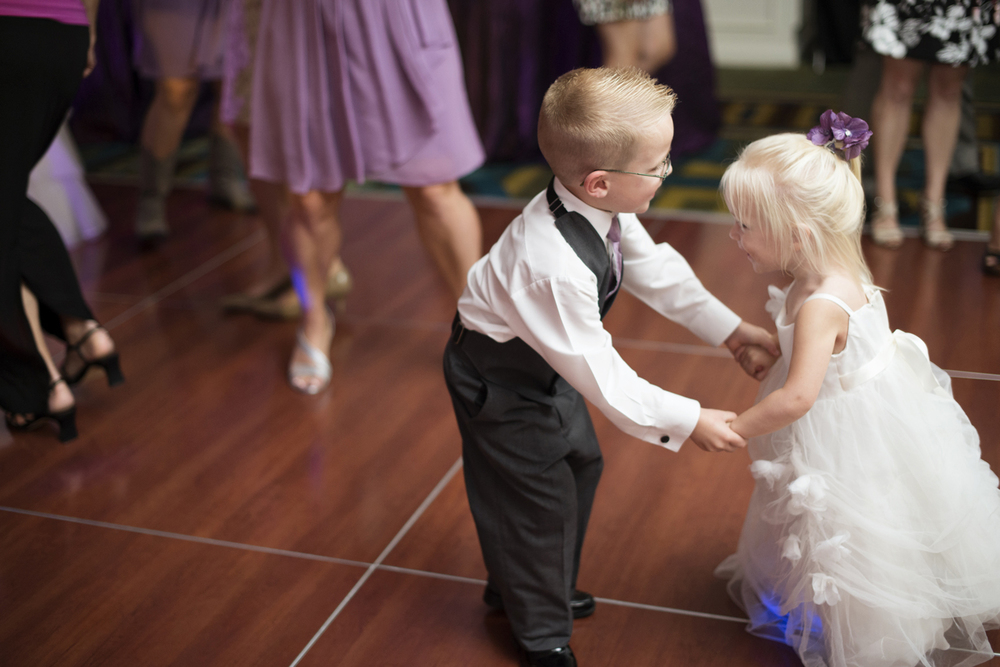 Flower girl and ring bearer dancing together | Fall hotel wedding in Virginia Beach