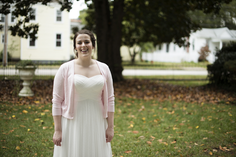 A bride laughing before her elopement at the Magnolia House Inn in Hampton, Virginia