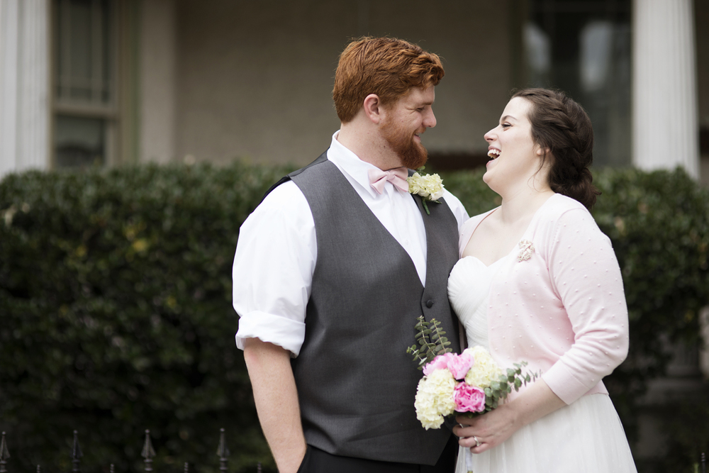 Bride in a pink cardigan and her groom after they elope