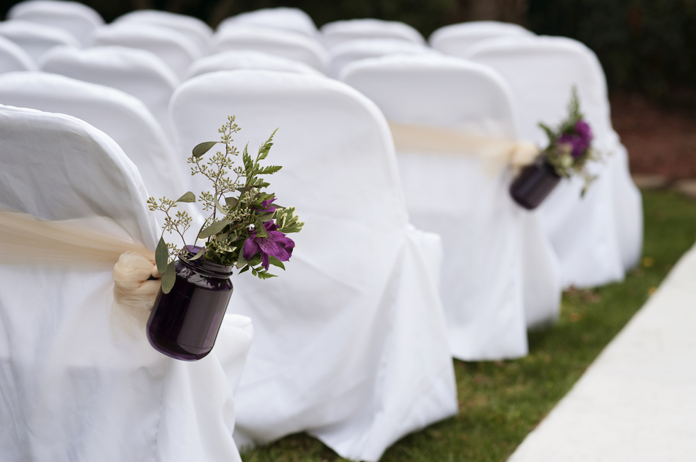 Purple mason jars at wedding ceremony