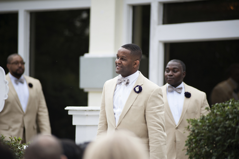 Groom walking into the ceremony at Traditions Grill in Chesapeake