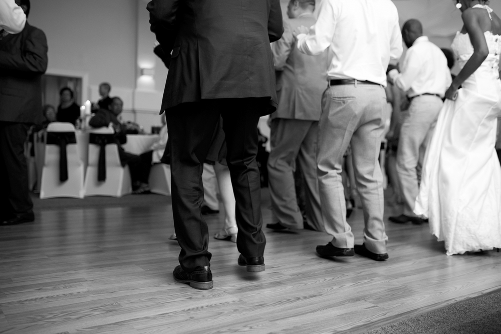 Wedding guests dancing at the reception (black and white)