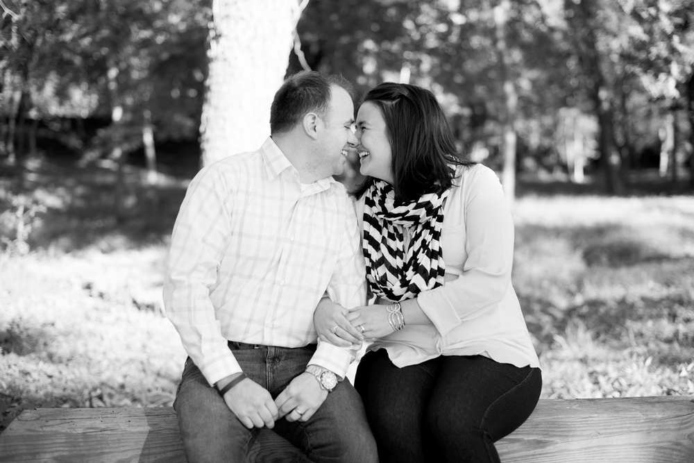Black and white of husband and wife laughing during family portraits