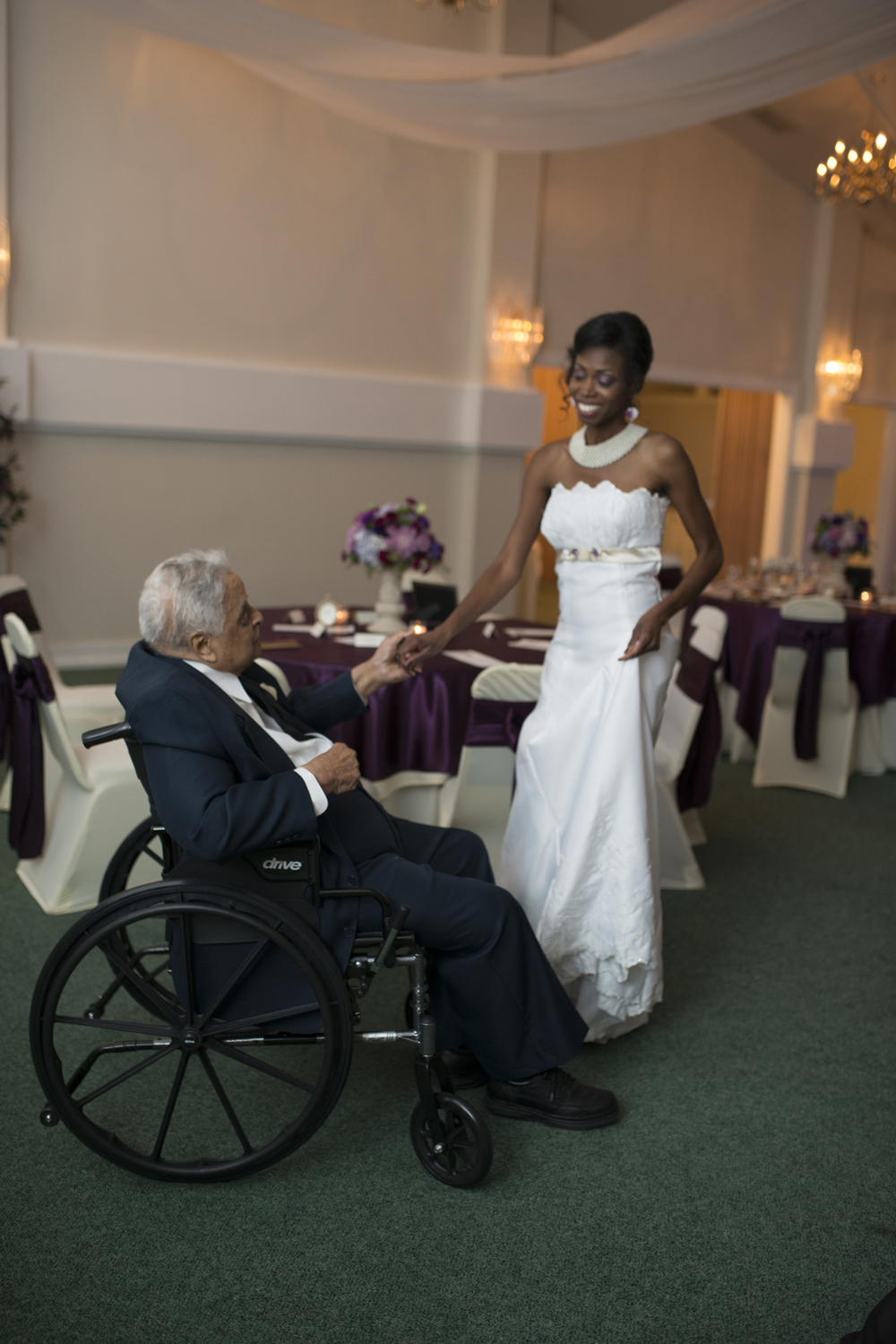 A bride dances with her grandfather on the wedding day
