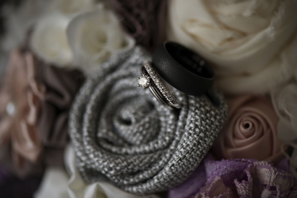 Wedding rings in a handmade gray burlap cloth bouquet