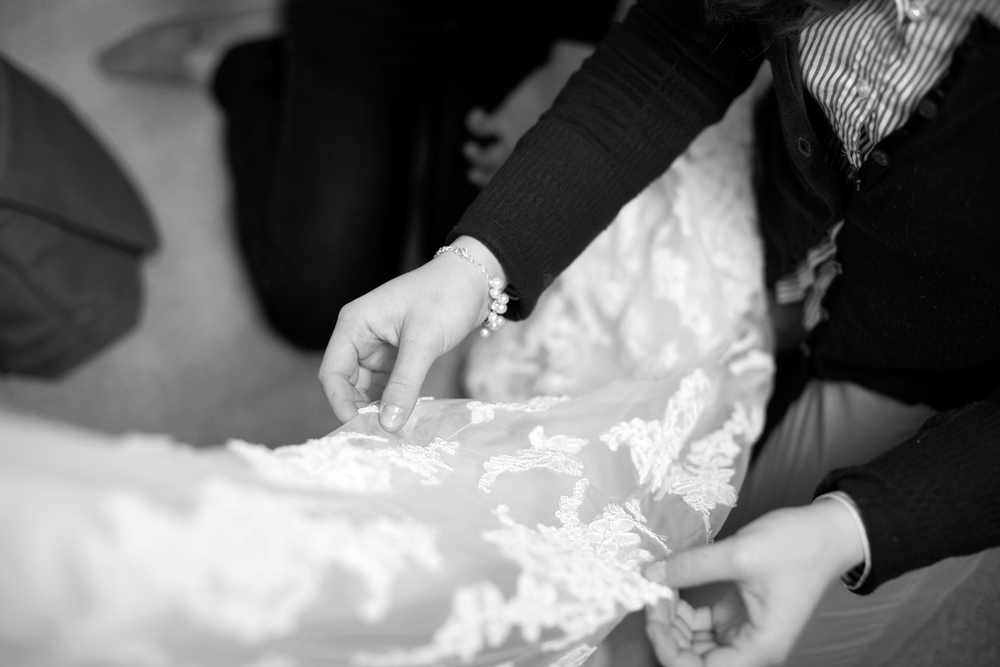 Lace wedding dress getting ready