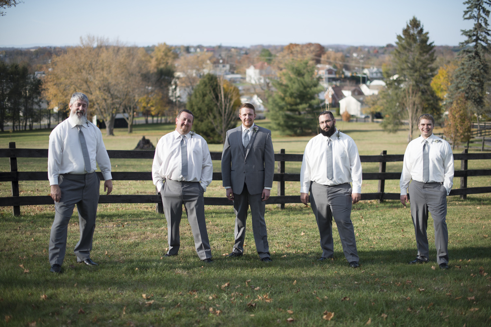Groomsmen in gray suits editorial pose outside