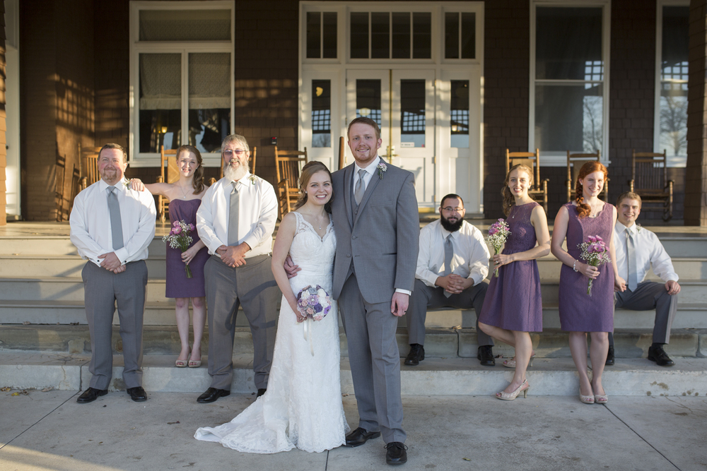 Bridal party in editorial pose outside wedding venue