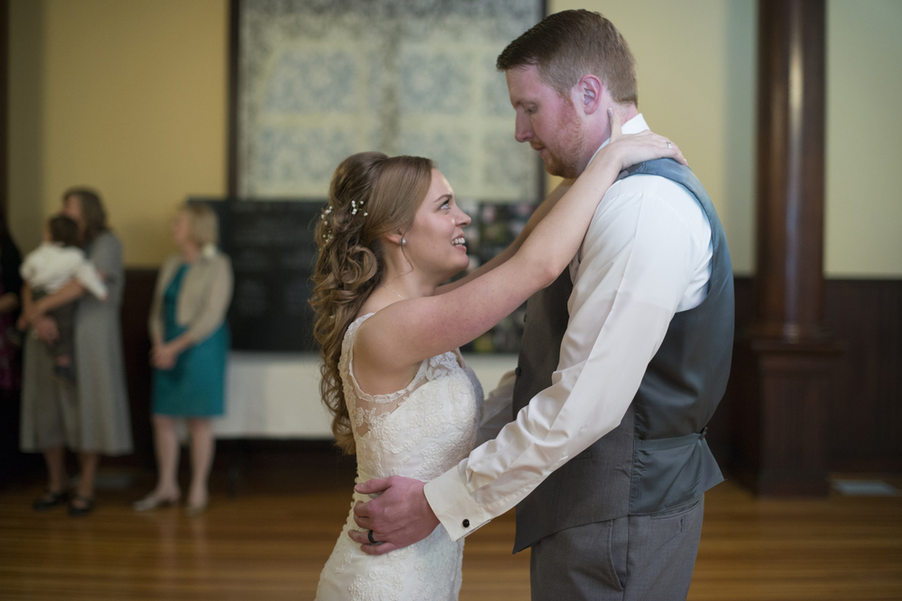 Bride and groom's first dance together at an indoor reception