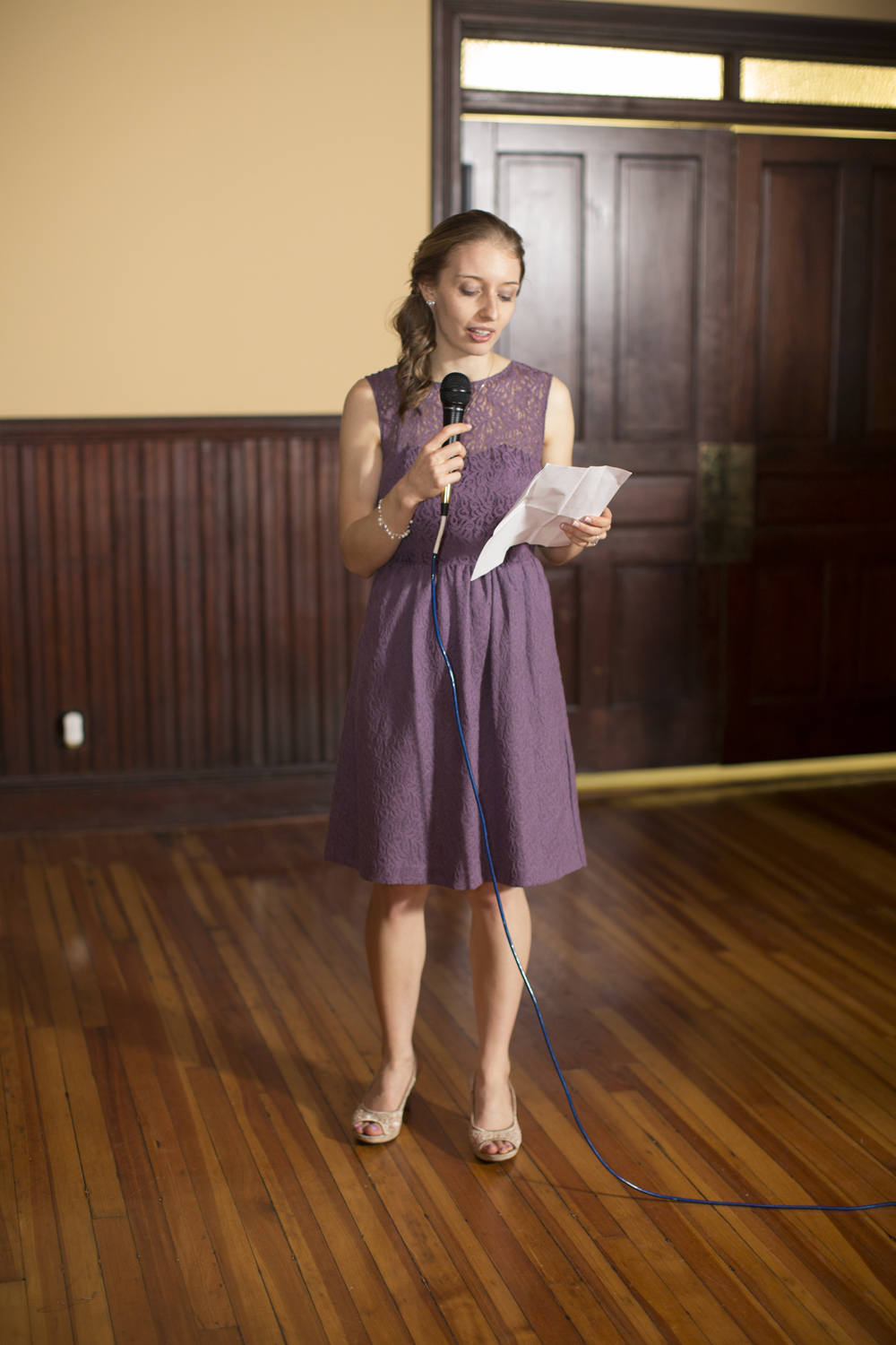Maid of honor in lavender dress wedding speech