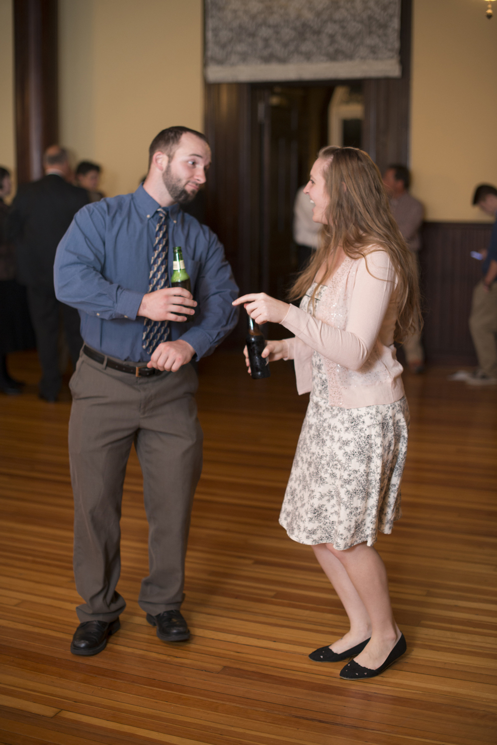 Wedding guests dancing at indoor reception