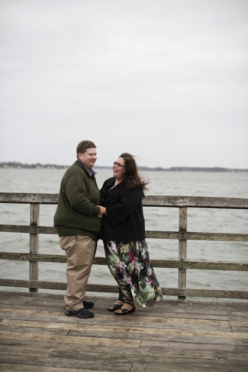 Engagement pictures on a dock by the beach