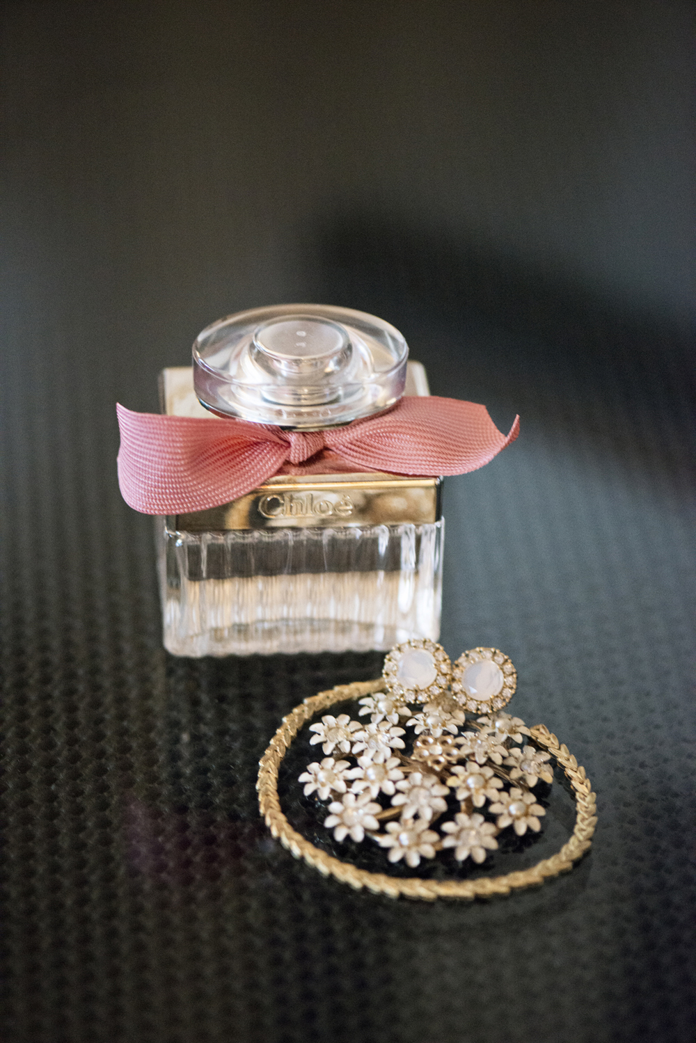 Chloe wedding perfume with pink bow and flower jewelry