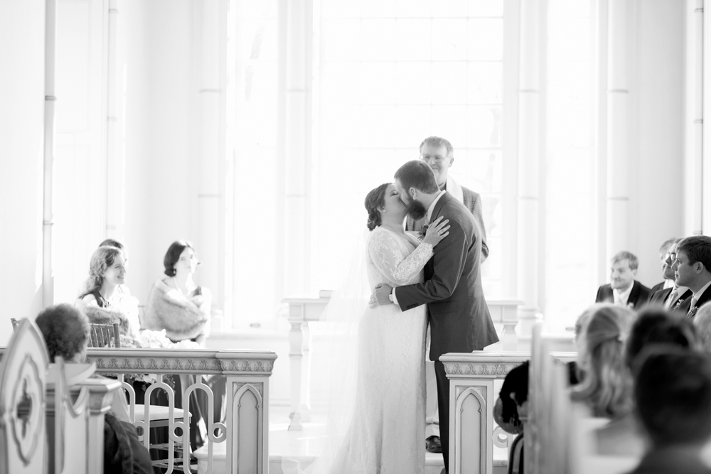 First kiss on the wedding day (black and white)