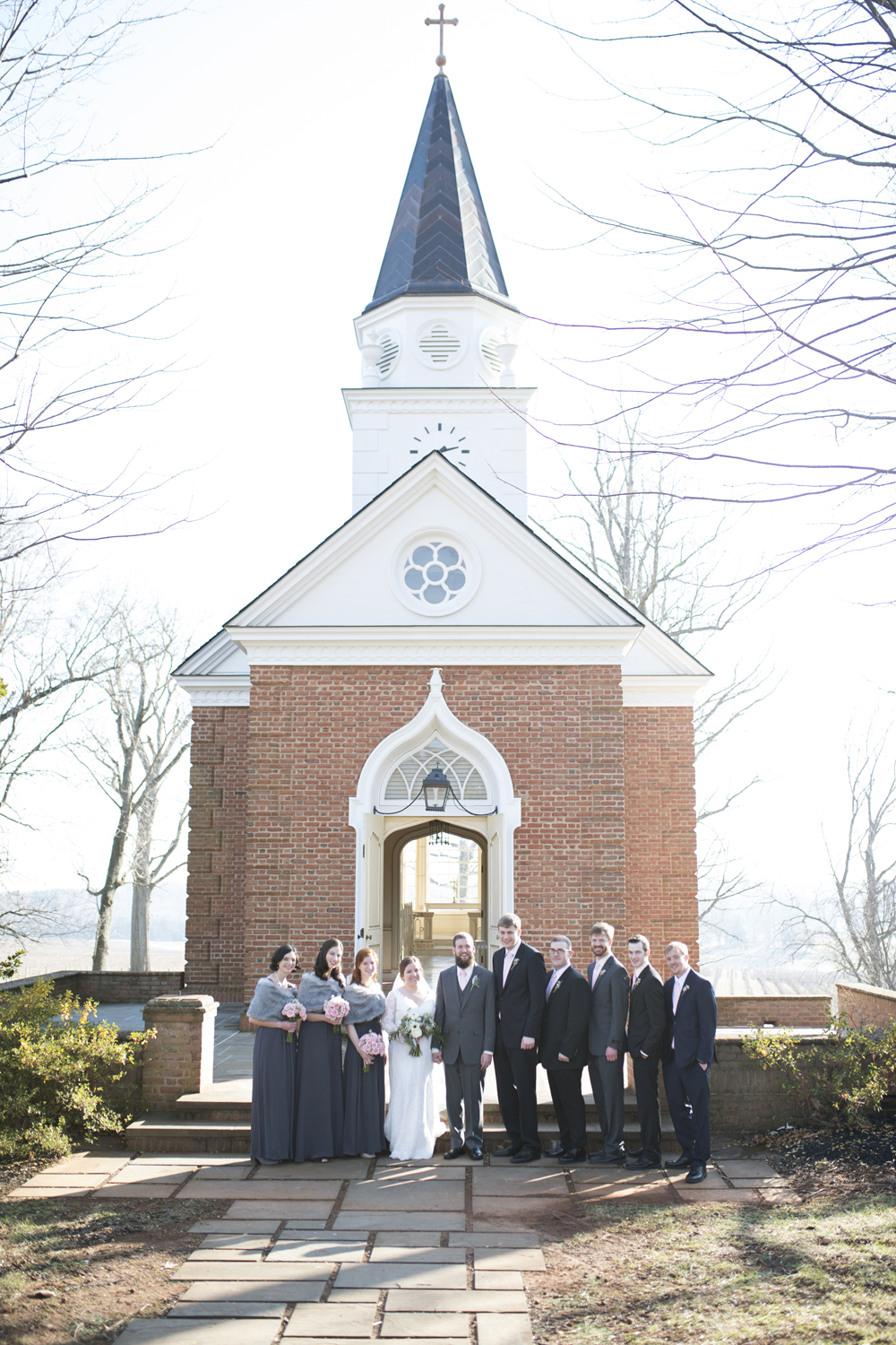 Bridal party portraits outside a vineyard wedding chapel