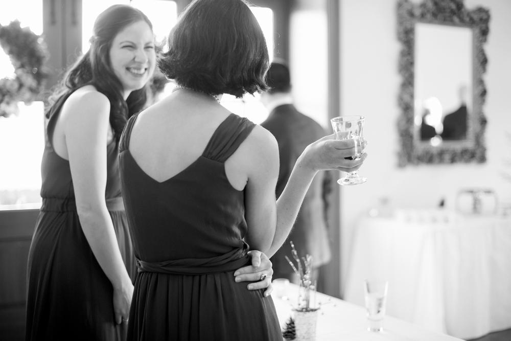 Bridesmaids talking at the wedding reception