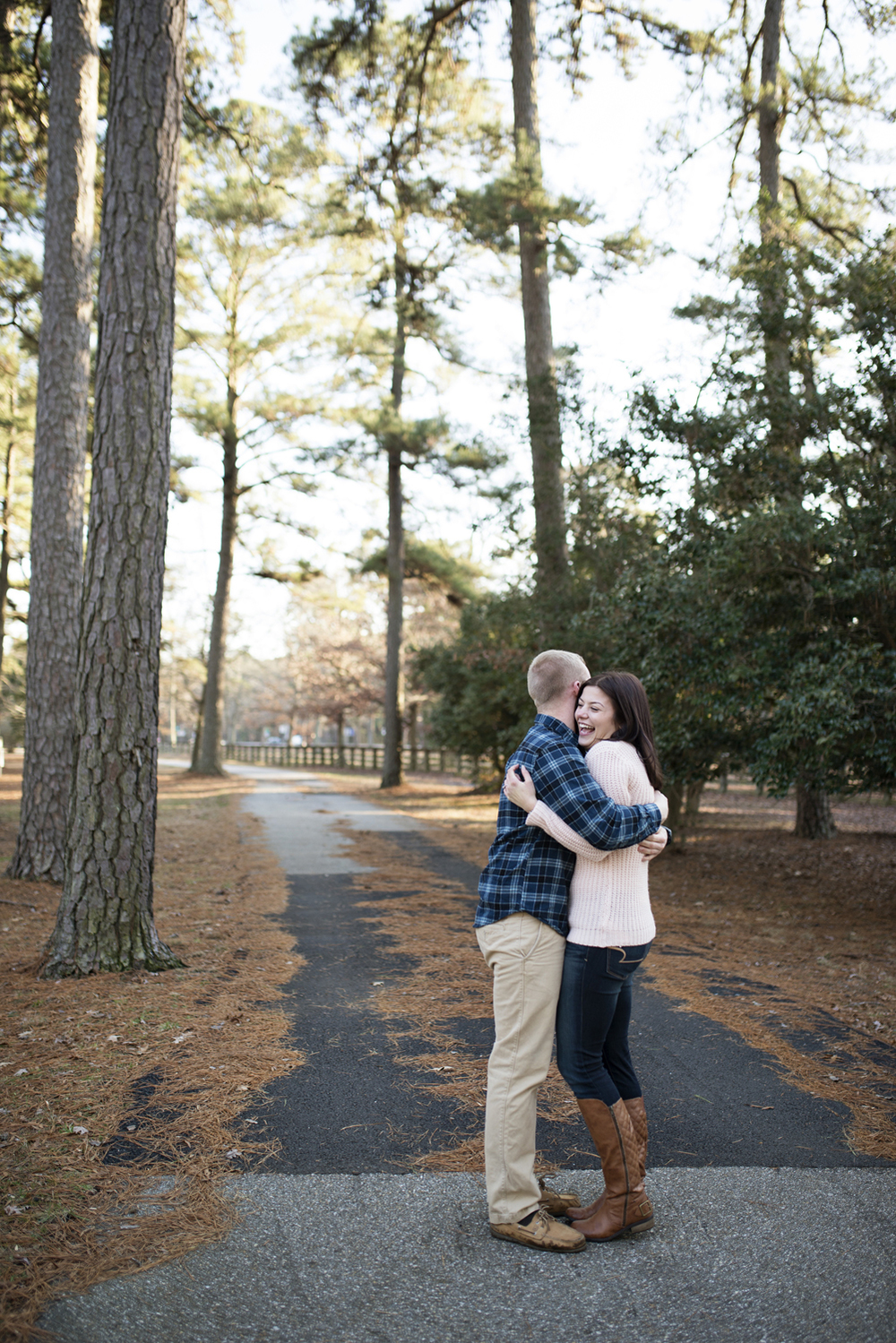 Engagement session in the woods with tall trees