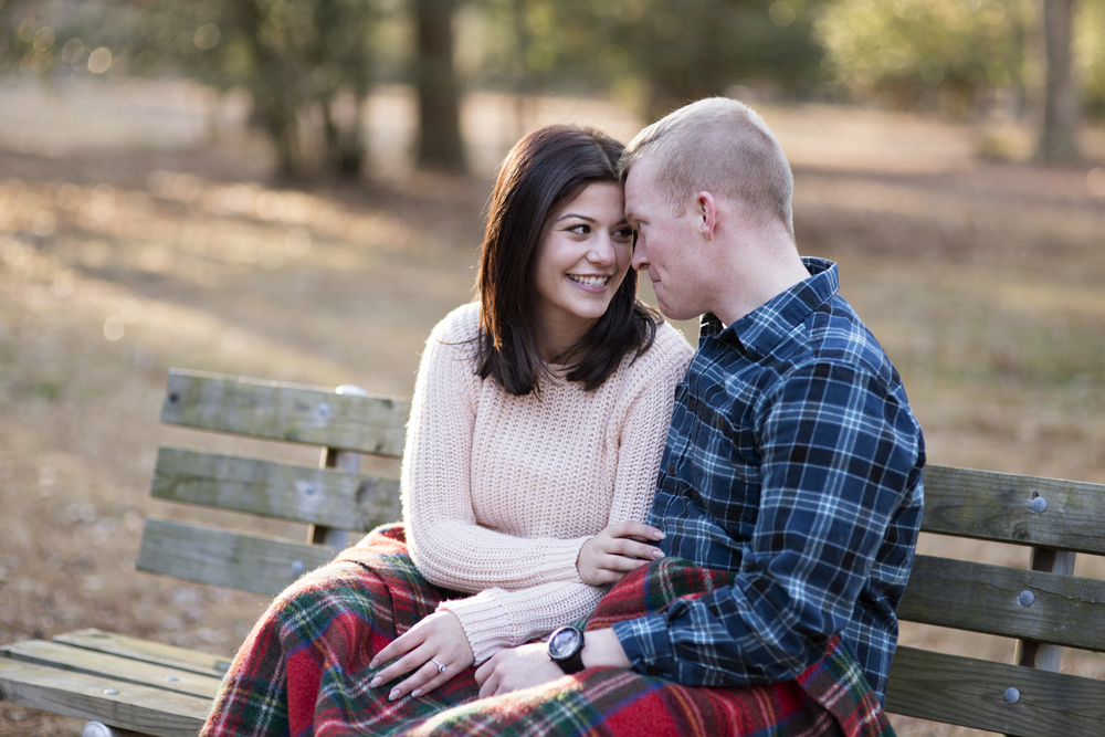 Engagement session pictures on a park bench
