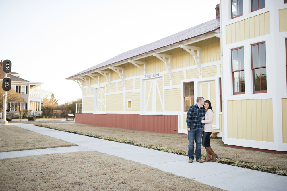 Engagement session poses in front of a building