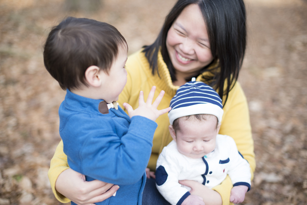 Winter family portraits session with yellow, blue, and white