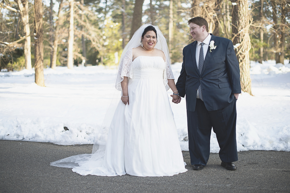 Snowy bride & groom portraits | Winter wedding | Cathedral veil