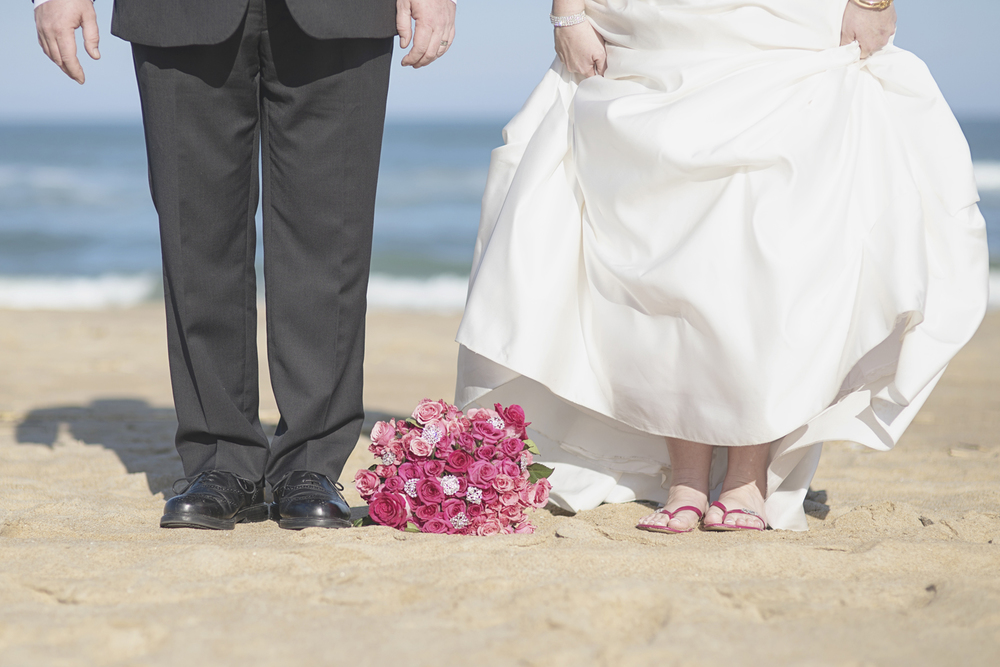 Beach bride and groom portraits | Virginia Beach wedding | Pink flip flops