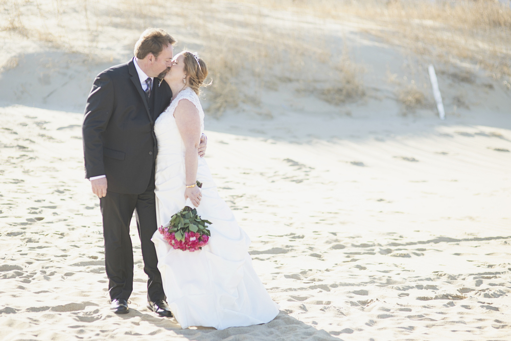 Beach bride and groom wedding pictures | Beach wedding | Pink, white, and silver wedding