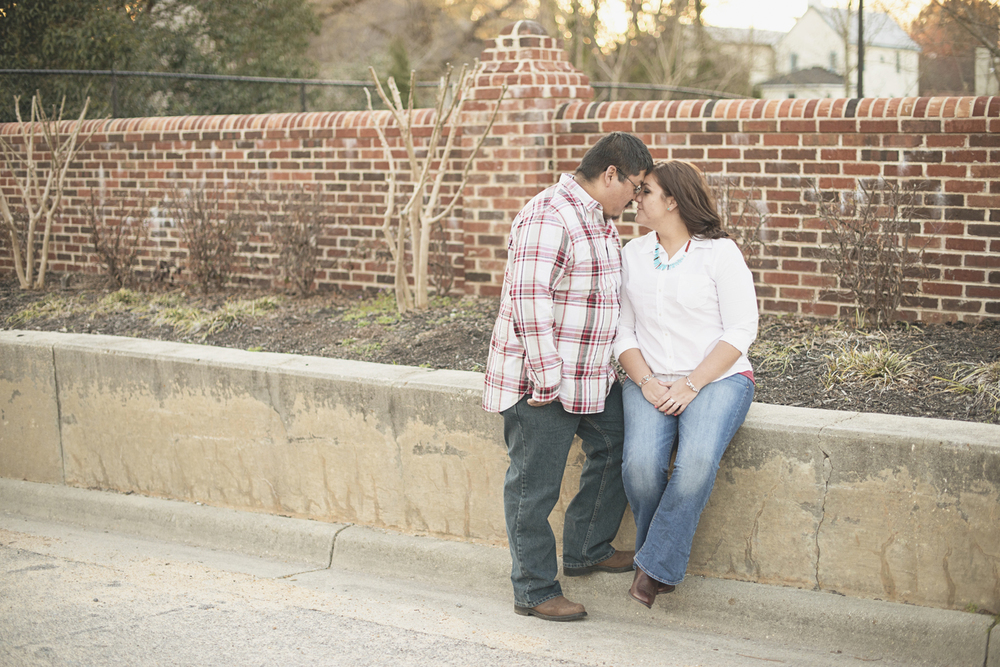 Cute engagement poses with a brick wall | Downtown engagement session