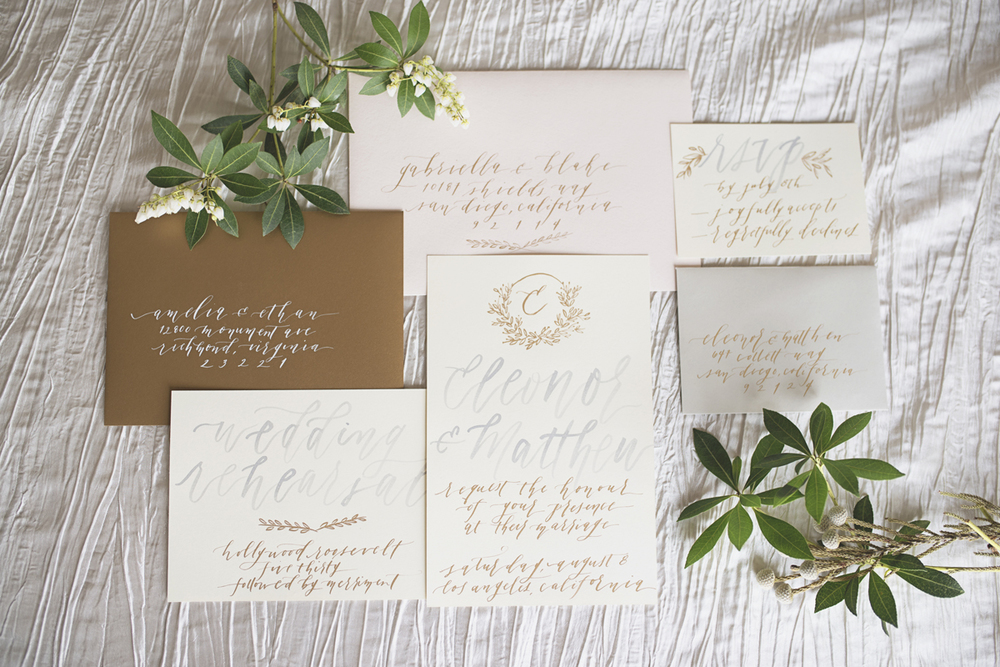 Gold, blush, and white wedding invitations