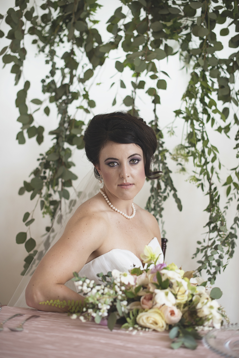Bridal portrait with vines in background