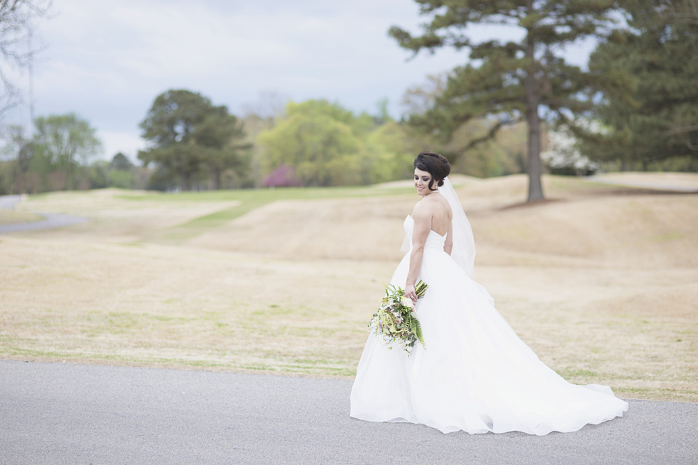 Bridal portrait by a field of grass