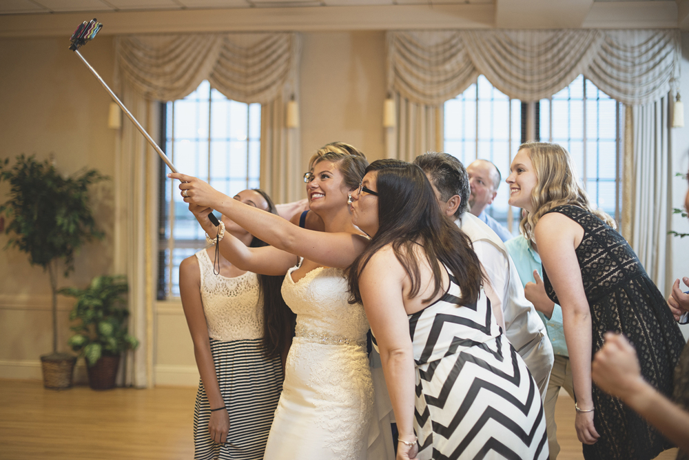 Langley Chapel Air Force Military Wedding | Hampton, Virginia | Wedding reception selfie stick