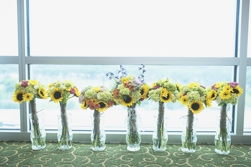 Langley Chapel Air Force Military Wedding | Hampton, Virginia Wedding | Bridesmaids and bridal bouquets with yellow sunflowers, lavendar, and peach