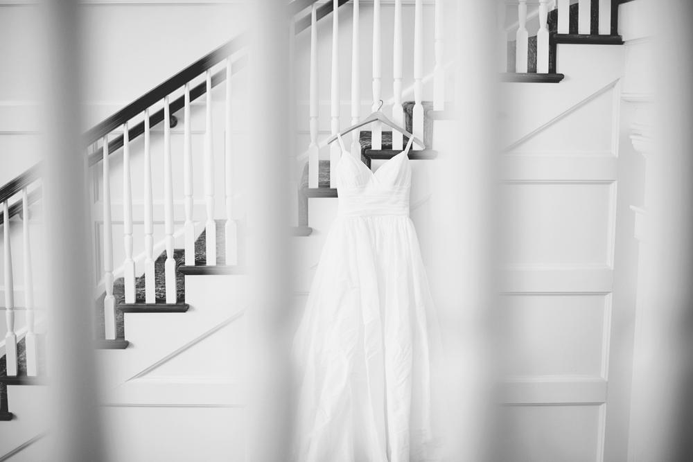 Trump National Golf Club Wedding | Washington, DC Wedding | Black and white wedding dress hanging on staircase