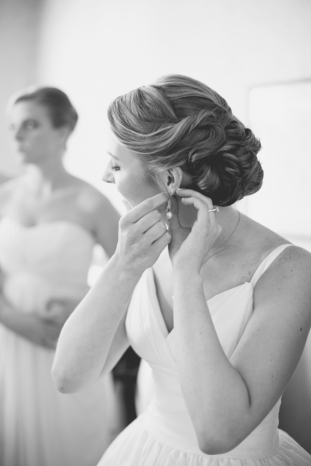 Trump National Golf Club Wedding | Washington, DC Wedding | Bride puts on her earrings in black and white