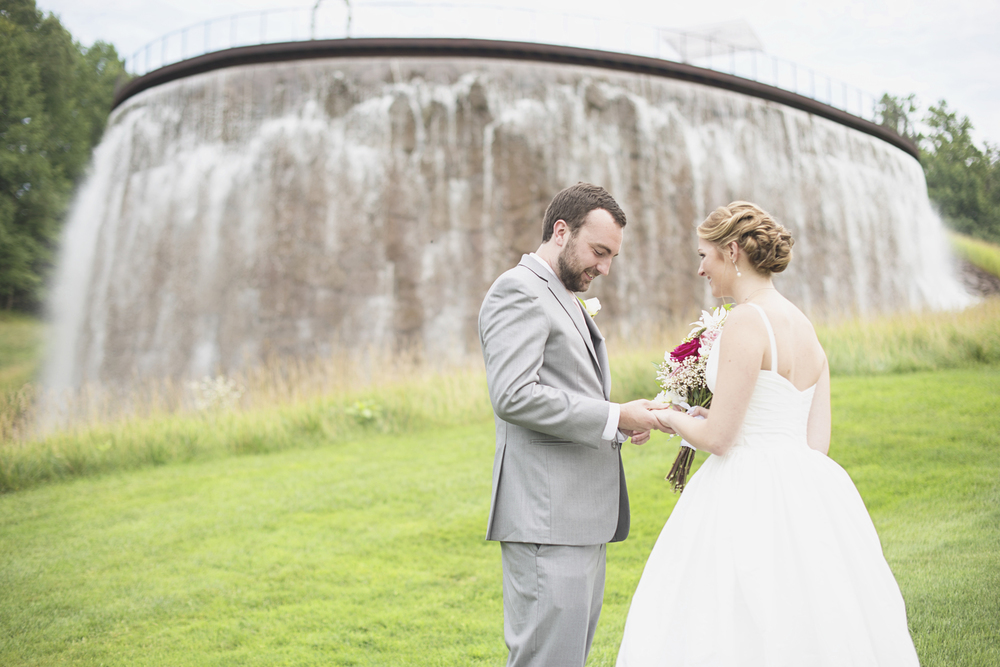 Trump National Golf Club Wedding | Washington, DC Wedding | Bride & groom first look portraits in front of a man-made waterfall
