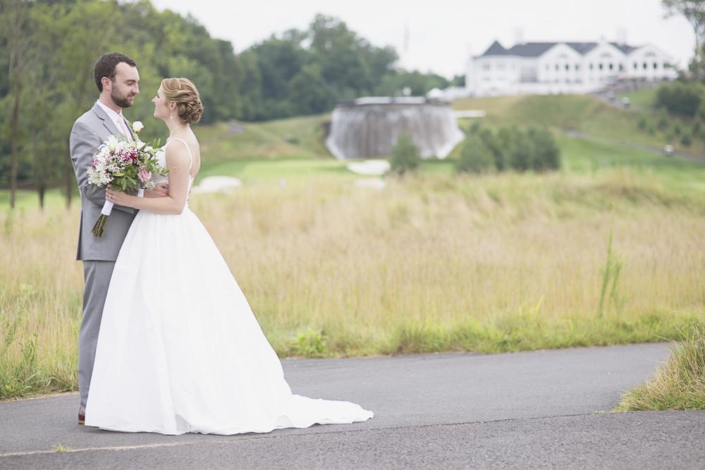 Trump National Golf Club Wedding | Washington, DC Wedding | Bride & groom portraits with waterfall and mansion