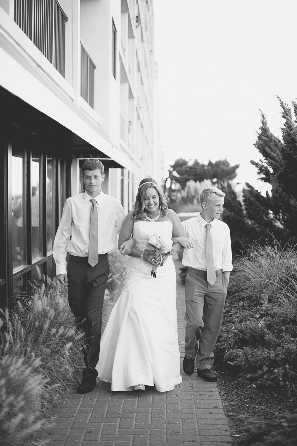 Virginia Beach Oceanfront Wedding | Bride walking down the aisle
