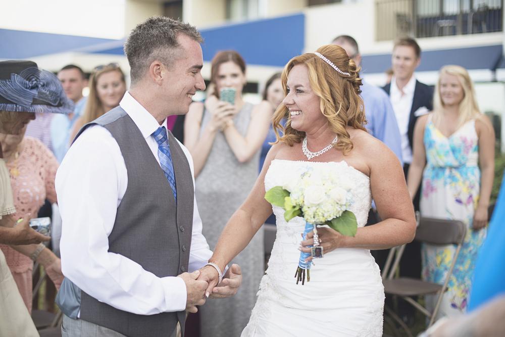 Virginia Beach Oceanfront Wedding | Bride meeting her groom at wedding ceremony