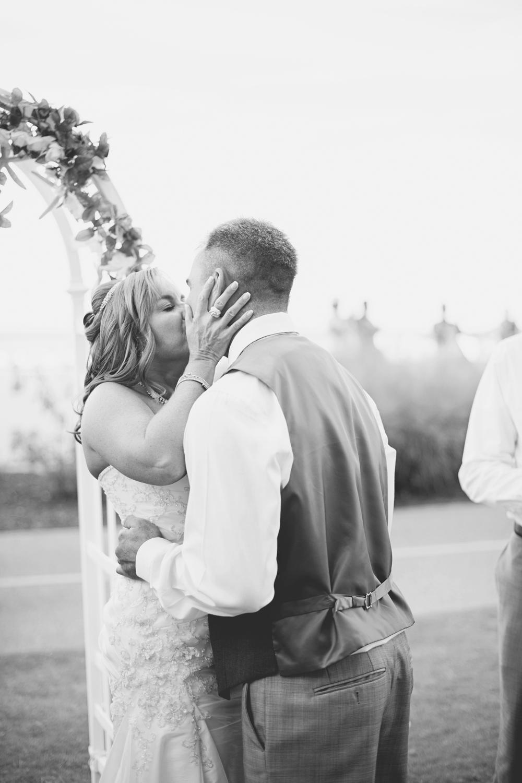 Virginia Beach Oceanfront Wedding | Bride and groom first kiss